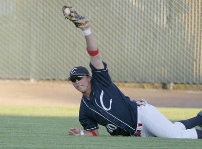 Josh Jackson/The Times-Standard  Crabs' #30 comes up with the ball after a diving catch during Monday's game in Arcata.