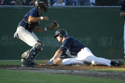 Josh Jackson/The Times-Standard  Crabs'  Craig Parry slides into home to score during Monday's game in Arcata.