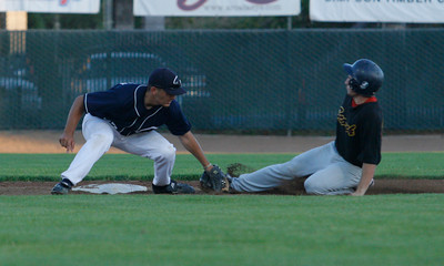 Josh Jackson/The Times-Standard  Crabs #22 tags out Scorch's #28 at second base during Friday's game in Arcata.