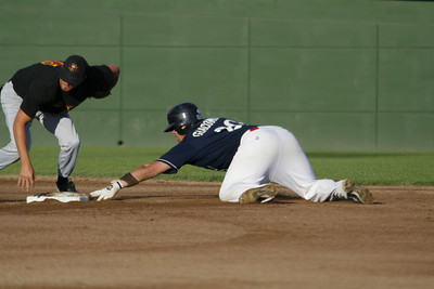 Josh Jackson/The Times-Standard Crabs' #20 is out despite getting two fingers on the base during Friday's game in Arcata.