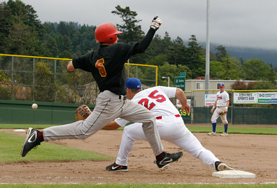 Josh Jackson/The Times-Standard  Crabs' #25 waits for the throw as Scorch's #5 charges to first base during Sunday's game in Arcata.