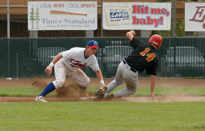 Josh Jackson/The Times-Standard  Crabs' Richard Cates goes for the out on Scorch's #14 during Sunday's game in Arcata.