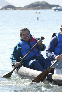 Shaun Walker/The Times-Standard  Axel Lidgren, who led the effort to restore the canoe, smiles as he paddles back to shore.