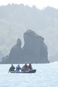 Shaun Walker/The Times-Standard  The canoe is paddled amid sea rocks on Trindad Bay.