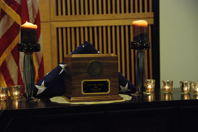José Quezada/For the Times-Standard  A wooden box holding the ashes of Kevin R. Ebbert are framed with an  American flag and candles, just a few feet away from a guitar Ebbert played while in college.   Special Warfare Operator 1st Class (SEAL) Kevin R. Ebbert, U.S. Navy, was remembered Sunday afternoon by family, fellow Navy Seals, life-long friends and many community members in a memorial service held in the Kate Buchanan Room at Humboldt State University.