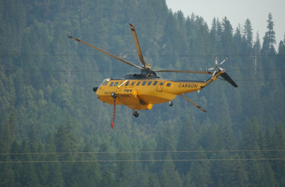 Mark McKenna/The Times-Standard Helicopters were flying from the Klamath River to drop water on the Elk Complex fire near Happy Camp on Monday.