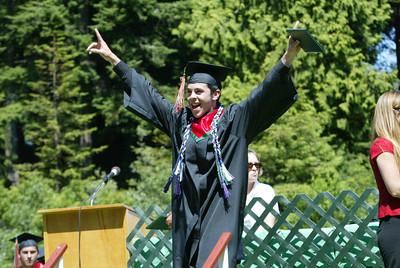 Shaun Walker/The Times-Standard  Juan Mu–oz celebrates after getting his diploma holder.