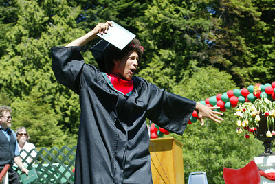 Shaun Walker/The Times-Standard  Joshua Roller celebrates after getting his diploma holder.