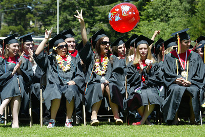 Shaun Walker/The Times-Standard  Eureka High School seniors yell and cheer during the ceremony.