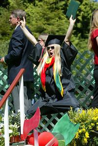 Shaun Walker/The Times-Standard  Kayla Throgmorton celebrates after getting her diploma holder.