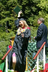 Shaun Walker/The Times-Standard  Kathryn Steiner celebrates after getting her diploma holder.