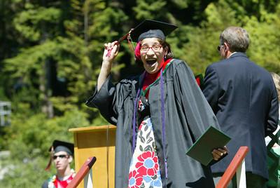 Shaun Walker/The Times-Standard  Toni Delgado celebrates after getting her diploma holder.