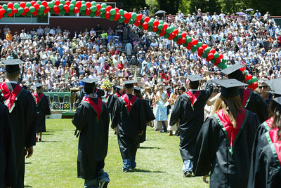 Shaun Walker/The Times-Standard  Eureka High School seniors are greeted by two lines of teachers as they walk to their seats at the start of their graduation ceremony.