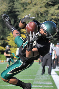 Josh Jackson/The Times-Standard  Jacks' #7 pull in a pass to score during the GNAC Championship game in Arcata on Saturday.