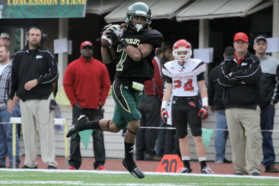 Josh Jackson/The Times-Standard  Jacks' #7 pulls in a pass during the GNAC Championship game in Arcata on Saturday.