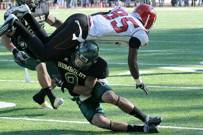 Josh Jackson/The Times-Standard  Jacks' #9 upends Wolves' #85 during the GNAC Championship game in Arcata on Saturday.