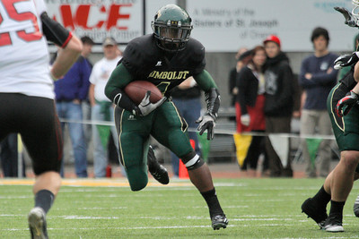Josh Jackson/The Times-Standard  Jacks' #4 charges downfield during the GNAC Championship game in Arcata on Saturday.