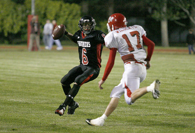 Josh Jackson/The Times-Standard  Panthers quarterback Kyle Johnson goes on the run as Wildcats' Shea McKay pursues during Friday's game at McKinleyville High School.