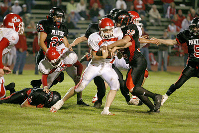 Josh Jackson/The Times-Standard  Wildcats' Jake Morris runs the ball as Panthers' Mike Larson goes for the tackle during Friday's game at McKinleyville High School.