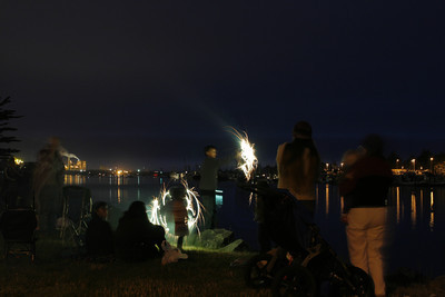 Josh Jackson/The Times-Standard  Spectators set off fireworks at Halvorsen Park along the waterfront on Humboldt Bay just before the fireworks display on Independence Day in Eureka.
