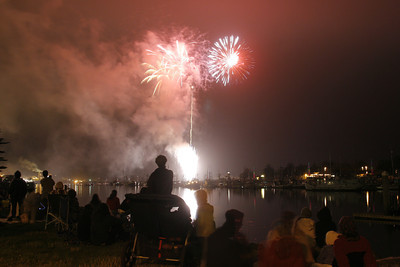 Josh Jackson/The Times-Standard  Spectators watch the fireworks display over Humboldt Bay at Halvorsen Park  on Independence Day in Eureka.