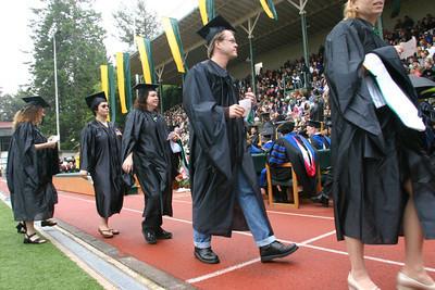 Josh Jackson/The Times-Standard  Graduates make their way to the stage to take their diplomas.
