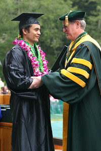 Josh Jackson/The Times-Standard  Justin Nash gets a congratulatory handshake from Humboldt State University President Rollin Richmond during the College of Arts, Humanities, and Social Sciences graduation ceremony on Saturday morning at HSU. Nash graduated with a Bachelor of Arts Degree in Music.
