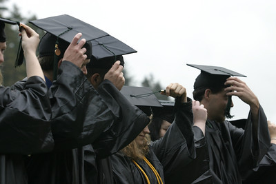 Josh Jackson/The Times-Standard  Graduates move their tassles to the opposite side to signify that they have officially made the grade.