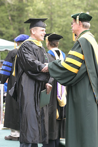 Josh Jackson/The Times-Standard  Christopher Panza gets a congratulatory handshake from Humboldt State University Rollin Richmond after receiving his diploma during the College of Natural Resources and Sciences graduation ceremony on Saturday at Humboldt State University. Panza graduated with a Master of Science degree in Environmental Systems.