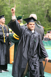 Josh Jackson/The Times-Standard  James Calderon III celebrates receiving his diploma during the College of Professional Studies graduation ceremony on Saturday at Humboldt State University. Bernard graduated with a Bachelor of Arts Degree in Elementary Education.