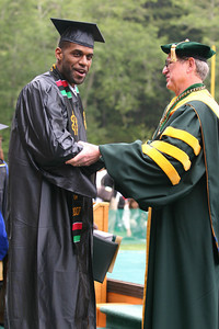 Josh Jackson/The Times-Standard  Devin Peal gets a congratulatory handshake from Humboldt State University President Rollin Richmond during the College of Arts, Humanities, and Social Sciences graduation ceremony on Saturday morning at HSU. Peal graduated with a Bachelor of Arts Degree in Journalism.