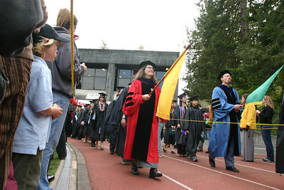 Josh Jackson/The Times-Standard  The procession makes its way into Redwood Bowl during the College of Natural Resources and Sciences graduation ceremony at Humboldt State University on Saturday.