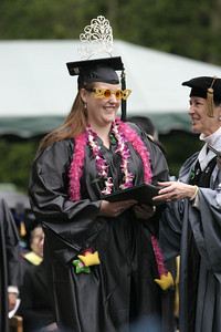 Josh Jackson/The Times-Standard  Briana Luers receives her diploma during the College of Professional Studies graduation ceremony at Humboldt State University on Saturday. Luers graduated with a Bachelor of Arts Degree in Recreation Administration.