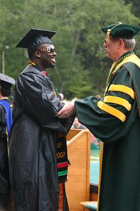 Josh Jackson/The Times-Standard  Markeese Jo'Von Wilson gets a congratulatory handshake from Humboldt State University President Rollin Richmond during the College of Arts, Humanities, and Social Sciences graduation ceremony on Saturday morning at HSU. Wilson graduated with a Bachelor of Arts Degree in Sociology.