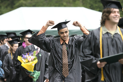 Josh Jackson/The Times-Standard  Avraham Bernard celebrates receiving his diploma during the College of Professional Studies graduation ceremony on Saturday at Humboldt State University. Bernard graduated with a Bachelor of Science Degree in Kinesiology.