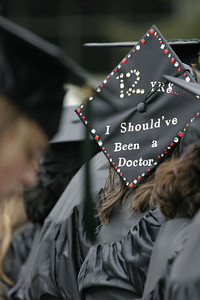 Josh Jackson/The Times-Standard  Graduates adorned their caps and gowns with custom messages and designs, like Katrina Carlsen's cap, pictured here.