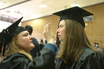 Josh Jackson/The Times-Standard  Laura Jaworksi, right, adjusts Erica Dykehouse's makeup before the College of Natural Resources and Sciences graduation ceremony at  Humboldt State University on Saturday. Both graduated with Bachelor of Science degrees in Nursing.