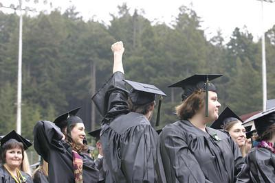 Josh Jackson/The Times-Standard  A graduate raises his fist in celebration.