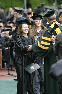 Josh Jackson/The Times-Standard  Stephanie Petersen gets a congratulatory handshake from Humboldt State University President Rollin Richmond during the College of Arts, Humanities, and Social Sciences graduation ceremony on Saturday morning at HSU. Petersen graduated with a Bachelor of Arts Degree in Communication.