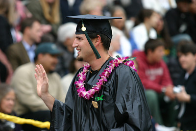 Josh Jackson/The Times-Standard  Gilbert Luna waves to the crowd after receiving his diploma during the College of Natural Resources and Sciences graduation ceremony on Saturday at Humboldt State University. Luna graduated with a Bachelor of Science degree in Geology.