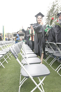 Josh Jackson/The Times-Standard  Sharon Levy heads to her seat during the College of Natural Resources and Sciences graduation ceremony at Humboldt State University on Saturday. Levy graduated with a Bachelor of Science Degree in Mathematics.