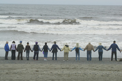 Shaun Walker/The Times-Standard  About 40 people join hands on Mad River Beach to show their opposition to offshore oil drilling on Saturday. The event, part of a worldwide campaign started in Florida called Hands Across the Sand, was also held to call for more for clean energy generation.