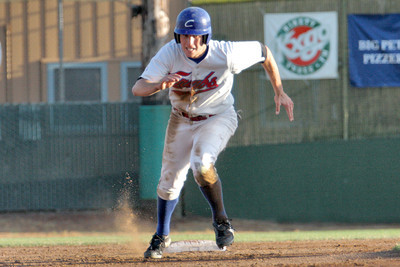 Josh Jackson/The Times-Standard  Crabs' #4 dashes for third base during Saturday's game in Arcata.