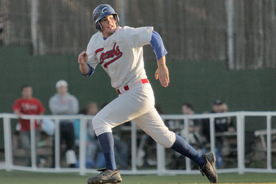 Josh Jackson/The Times-Standard  Crabs' #24 watches the play as he sprints for second base during Saturday's game in Arcata.