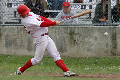 Josh Jackson/The Times-Standard  Falcons' Cody Johnsen gets a hit during Friday's game in Cutten.
