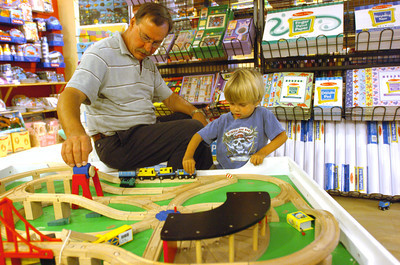 Mark McKenna/The Times-Standard Jessiah Class looks at toys at Geppeto's in Arcata with David Boston, a nurse who has help care for Jessiah since he was two months old.