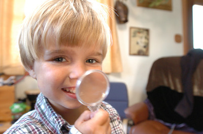Mark McKenna/ The Times-Standard Jessiah Class plays with a toy magnifying glass at his home in Arcata.