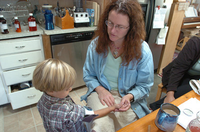 Mark McKenna/ The Times-Standard Kim Class checks her son Jessiah's blood pressure. Ê