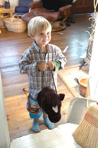 Mark McKenna/ The Times-Standard Jessiah Class rides a toy pony while playing with toys at his family home in Arcata. Ê