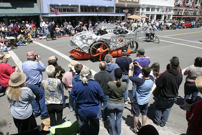 """Josh Jackson/The Times-Standard Duane Flatmo and team' s """"Armored Carp"""" makes a victory lap at the finish line during the finish of the Kinetic Grand Championship in Ferndale on Monday. The recycled metal entry took home the First Place Art Award."""